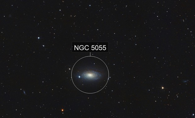 Messier 63 with a surrounding triplet