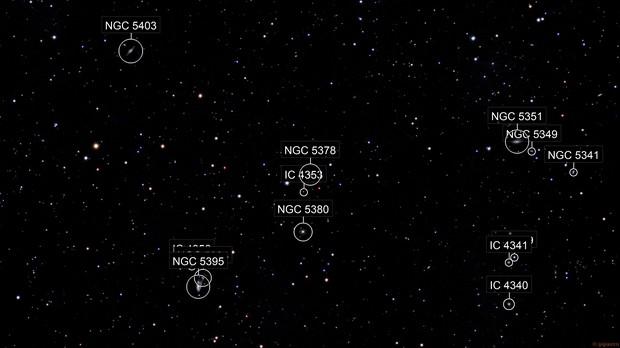 """A """"Cosmic Triangle"""" in Canes Venatici"""