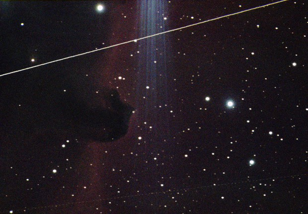 Satellites Passing By the Horsehead Nebula