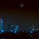 Luna al tramonto su Milano,                                Alessandro Curci