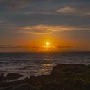 Sun setting on the ocean's horizon,                                Kapil K.
