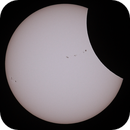 Partial Solar Eclipse among the sunspots.,                                David Frost