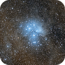 Pleiades cluster (M45) among clouds,                                George.K