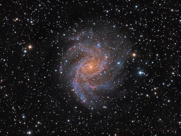 Fireworks Galaxy,                                Warren A. Keller