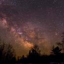 Milky Way over treeline,                                Chad Andrist