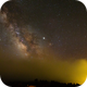 Milky Way emerges from clouds over La Palma,                                JuergenB