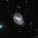 NGC 1097—Interacting with NGC 1097a,                                Russ Carpenter