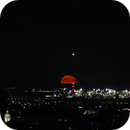 Moonrise behind Vienna Airport together with a approaching plane,                                nonsens2