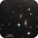A couple of tiny galaxies near M83,                                Rick Stevenson