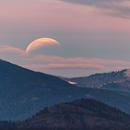 Eclipsed Moon setting at sunrise,                                Debra Ceravolo