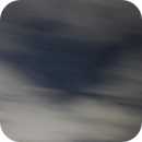 Orion peeking out from behind the clouds,                                James Muehlner
