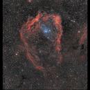 Sharpless 129 and a planetary nebula candidate, OU4 ,                                Metsavainio