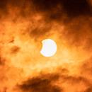 Partial solar eclipse,                                Evan Tsai