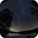 Milkyway over lakeside, framed by trees,                                Stephan Linhart