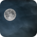 SuperMoon between the clouds,                                Alessandro Merga