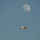 full moon and jetliner,                                Midnight