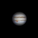 Jupiter as Io begins to transit,                                stricnine
