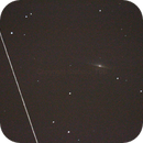 M 104 galaxy with artificial satellite rotating quickly on its axis,                                Stefano Tosi