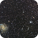 Fireworks Galaxy and nearby open star cluster,                                Rob Boyer