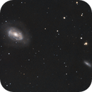 A Peek at NGC 4725 and Friends,                                AwesomeAstro
