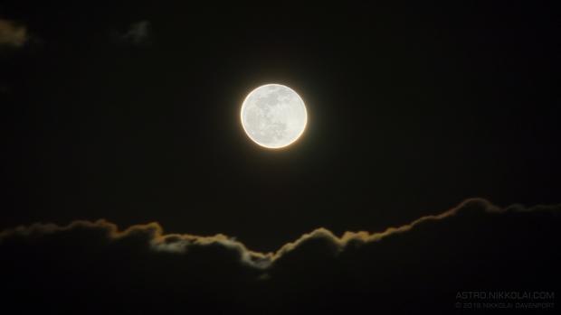 Moon rising above the clouds,                                Nikkolai Davenport