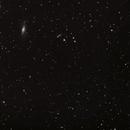 M106 and galactic friends,                                Henrik R
