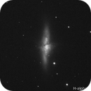 Hydrogen alpha and near infrared Cigar Galaxy,                                apricot