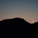 Moon almost behind the mountain,                                Bert Scheuneman