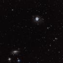 M77 and Its Galactic Neighbors,                                George Simon
