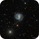 NGC 1672: A Peculiar Galaxy with Companions,                                Russ Carpenter
