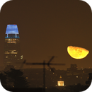 The moon rising next to Salesforce Tower,                                James Muehlner