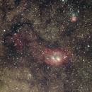 Messier 8 & 20 - Lagoon and Trifid Nebulas within the Milky Way,                                Jon Stewart