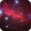 B33 Horsehead and NGC2024 Flame Nebula (with lens flare),                                Gilbert Ikezaki