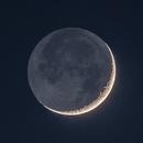 Crescent moon and earthshine,                                Dan Gallo